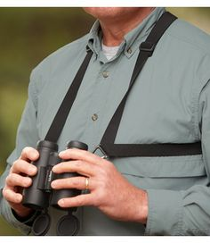 <p>Binoculars hanging by a neck strap can be uncomfortable and get in the way when shouldering a gun or drawing a bow. Our harness holds your binoculars in place, close to your chest where they'll be ready to use, but not in your way or swinging around. Elastic straps adjust for a good fit. Rugged clips allow you to attach and remove binoculars quickly.  <P>Imported.</p>
