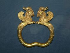 Pair of gold armlets from the Oxes Treasure (5th-4th century BC), one of the most important surviving items of ancient Persian craftsmanship. In the shape of winged griffins. The hollows chased into the horns, face and body of the monsters were originally inlaid. British Museum