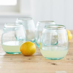 """FIRESIDE WINE TUMBLERS, SET OF 4--Handblown of subtly green recycled glass, these generously curved wine tumblers celebrate the season in an eco-friendly way. Colombia. Dishwasher safe. Set of 4. Each 8 oz., 5-3/4""""H."""