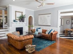 The living area was radically transformed by taking out walls, raising the ceiling and adding rich hardwood flooring, new crown molding and trim.