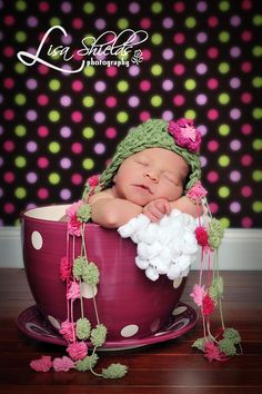 I love this polka dot backround and that baby hat is too cool
