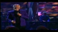 Kenny Rogers - She Believes In Me, via YouTube.