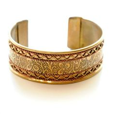 """Fairtrade Copper and Brass Flower Cuff Catherine Nicole. $22.00. Brass and Copper Cuff. Handmade by artisans in India. Adjustable and measures 1"""" wide. Fairtrade"""