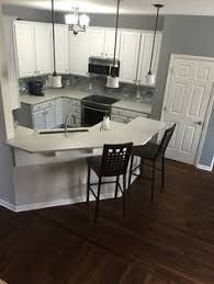 walnut kitchen cabinet grey walls white molding wood floor home home 3341