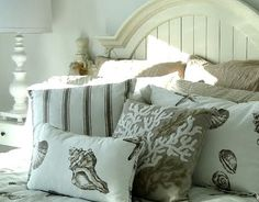 coastal cottage bedroom - love the pillows with the shells and coral - seaside living with a neutral color scheme