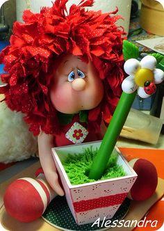Boy in flower pot