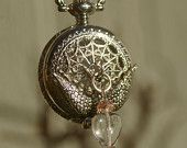 Lattice work Watch Pendant with Swallow and Glass Beads, This site has amazing jewelery as well as herbal teas