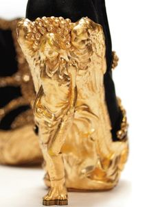 Alexander McQueen Angel Wing Gold and Black Platform Ankle Boots.