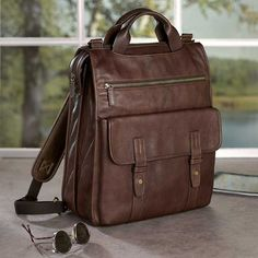 We've found your perfect bag. You can carry this ruggedly elegant men's leather backpack three ways: over both shoulders (via the backpack straps), cross-body (shoulder strap), or by hand (dual handles).