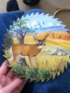 Painted Cross Cut Saw Blades   painting of a deer on a saw blade