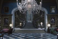 'Dark Shadows' ~ Fading Gothic grandeur is seamlessly combined with maritime motifs that reference the Collins family's ties to the sea.  The floor of the grand foyer is tiled in a blue-and-white pattern that evokes ocean waves, and upon closer examination, the immense chandelier overhead proves to have milky white octopus tentacles snaking among the strings of crystals.