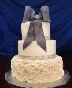 Wedding cake with one tier rosettes, bling border, & metallic fondant bow