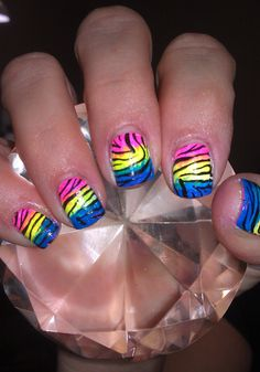 Shelbey Hardison pink, yellow, and blue neon zebra stripe nails.