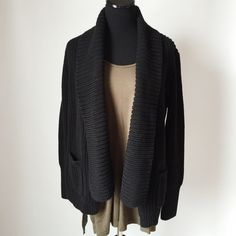 """J. Crew Rib-Stitched Open Cardigan J. Crew Rib-Stitch Open Cardigan in black.  Chunky knit and heavy.  Pre-loved but in excellent condition.  No holes, stains or tears.  Measurements laying flat: Armpit to armpit: 18"""" Waist (across): 17"""" Total length: 26.5"""" Sleeve length: 25"""" J. Crew Sweaters"""