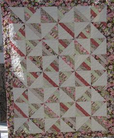 Spinning Strips #116, a pinwheel-style variation of a Roman Stripe quilt
