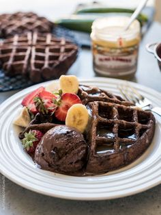 Chocolate Zucchini Belgian Waffles - hidden in the nooks and crannies are good-for-you zucchini! Use up summer zucchini in a chocolatey breakfast (or decadent dessert! Chocolate Waffles, Vegan Chocolate, Zucchini Waffles, Delicious Desserts, Dessert Recipes, Dessert Healthy, Belgium Waffles, Bubble Waffle, Good Food