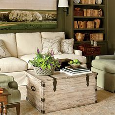 Comfortable seating, plenty of side tables, bookshelves = a cozy study. Tips for a Cozy Study