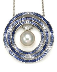 A South Sea Cultured Pearl, Sapphire and Diamond Ocean Ripple Pendant with Chain, Mikimoto Centering a South Sea Cultured Pearl measuring approximately 12.9mm, accented with a Round Brilliant Diamond and surrounded by three undulating gradated Sapphire Circle Pendants