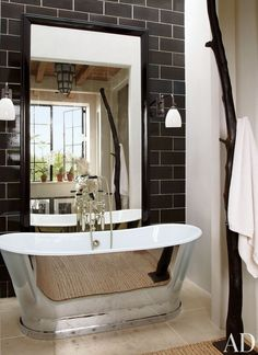 Beautiful Rustic Bathroom Designs With Silver And White Bathtub And Black Bathroom Wall Color And Big Mirror