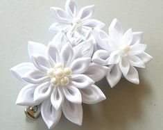 A flower is made in the technique of tsumami kanzashi.    Flower is made from satin ribbons.    Flower`s d is ~ 3 inches ( 7-8 cm)    MADE TO ORDER.    At