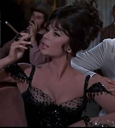 Maggie DuBois (Natalie Wood) smoked cigars in real life and in the movies, as attested by this moment  from The Great Race