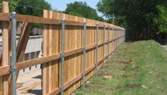 3 rail cedar privacy fence on steel posts