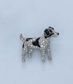 AN ART DECO BROOCH Designed as a pavé-set diamond dog, enhanced by black enamel, mounted in platinum, circa 1925