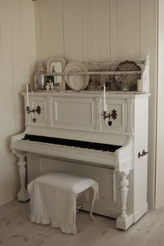 White piano with shelf
