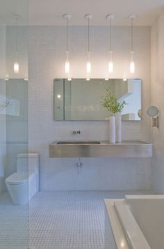 Pendants in the bath?  Hmmm... hadn't considered that!     Hampden Lane House / Robert Gurney Architect