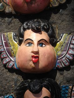 Mexican Folk Masks at Coyoacan Market by Gustavo Thomas, via Flickr