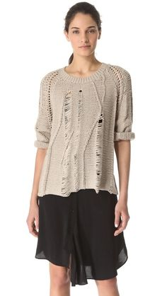 Ripped sweater and uneven skirt. Tess Giberson Disintegrating Cable Sweater