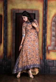 A purely western gown with a long tailed flair and fall flair back neck with a lil touch of Eastern embellishment.......