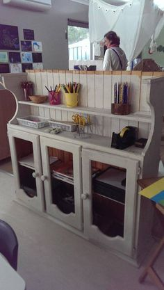 Re-purposed kitchen cabinet used as a classroom storage/shelve at Explore and Develop centres via Let the children play ≈≈