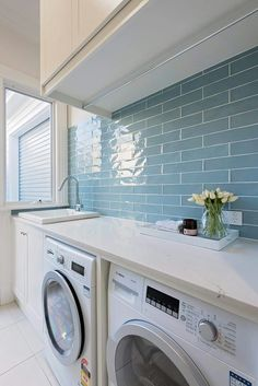 A small laundry room can be a challenge to keep laundry room cabinets functional, yet since this laundry room organization space is constantly in use, we have some inspiring design laundry room ideas. Laundry Room Tile, White Laundry Rooms, Laundry Room Cabinets, Farmhouse Laundry Room, Laundry Room Organization, Small Laundry, Storage Cabinets, Basement Laundry, Storage Shelves