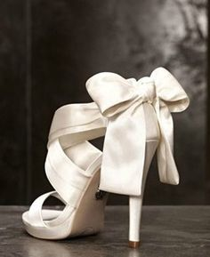 Vera Wang wedding shoes....if they were only 3 inches shorter, or I could walk in sky high heels!