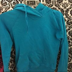 H&M Hoodie Light Blue/Aqua h&m hoodie. Size 4. So id say it would fit between an xs-s. Im a Small, and its close to my skin but not skin tight.  LIGHT Faded from old age. H&M Sweaters