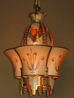 Art Deco Beardslee Chandelier ~ This fixture was designed to hold a smaller shade in the center to protect your eyes from the bare bulb and  this   smaller shade is a signed Quezal art glass shade, Height as shown: 41 1/2 inches which can be adjusted Width: 15 1/2 inches Asking $4,000 USD