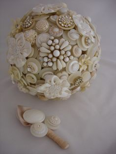 Beautiful sphere of vintage pins and buttons!