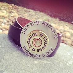 """Genuine leather wrap cuff with shotgun shell accent on Hand stamped tag, """"little girls are made of gunpowder and lead"""" on Etsy, $39.00"""