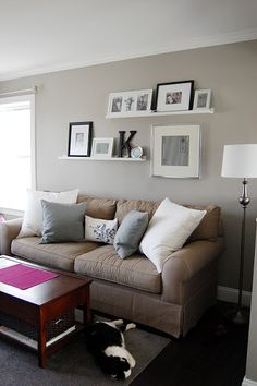 picture ledge above couch