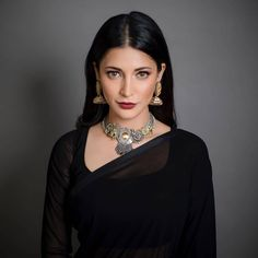 Recently for her father's special screening of his 2000 film 'Hey Ram', Shruti Hassan went for a sheer black georgette saree matched with a long sleeved blouse and statement jewellery. Indian Actress Photos, South Indian Actress, Beautiful Indian Actress, South Actress, Indian Celebrities, Bollywood Celebrities, Bollywood Actress, Bollywood Fashion, Hey Ram