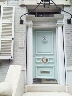 Pale blue door with chrome center knob.