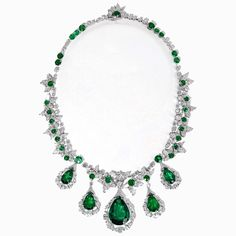 David Morris necklace in white gold set with 65.50ct of pear-shaped Colombian emeralds with white diamond marquise surrounds