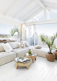How amazing is this stunning feature window with Hamptons style bifold doors leading onto deck with ocean front views! 🍃 😍 We are loving this stunning Australian Hampton style beach house with costal design ✨ filled with lots of NEW Uniqwa furniture.... Collins Sofa, Inkolo Coffee Table, Bara Baskets, Geometric Floor Lights, Ingoma Vase, Village Console. Photography #villagestyling Location #hamptionsholidayhouse ♥️ Click the link to our website for more info and trade prices! ♥️