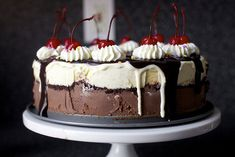 Hot Fudge Sundae Cake - Deb at Smitten is 100% absolutely insane, and thus decided to DIY every single component of this cake, from ice cream to cookies to fudge sauce. The good news is that you have no obligation to do the same — you could just buy and assemble all of the ingredients and it would still be awesome. Recipe .....http://smittenkitchen.com/blog/2013/07/hot-fudge-sundae-cake/