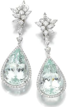 Aquamarine and #diamond earrings by Margherita Burgener. Each foliate diamond surmount on suspends a pear-shaped aquamarine within a border of brilliant-cut diamonds. Via Diamonds in the Library.