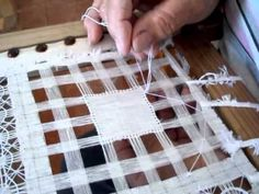 """Drawn Thread video demonstration in Spanish ~ """"Redondillo majorero"""" al detalle (parte 1 de 3) - YouTube (this video shows the initial layers of intersecting threads which all seem to be worked with the same knot stitch. I can't believe how quickly this embroiderer works! I would love to be this accomplished!)"""