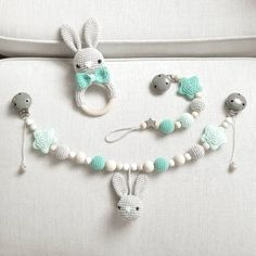 Knitting Patterns Gifts Bunny set of pram chain, pacifier chain and rattle in gray / turquoise morning goes on . Crochet Baby Toys, Crochet For Kids, Crochet Dolls, Baby Sewing Projects, Crochet Projects, Knitting Patterns, Crochet Patterns, Baby Mobile, Teething Necklace