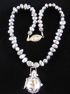 Iridescent blue/purple fresh water pearl necklace by jacsjewelsnow, $70.00