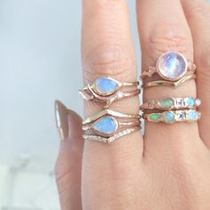 The more the better! Compass Opal Rings, Mini Beak Rings, Morro Moonstone Ring, Journey Treasure Mermaid Rings | get all of these now at Misa Jewelry!